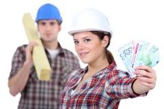 2 плотника зарабатывая деньги Стоковые Фото