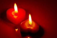 2 свечки горящих сердца форменных Стоковое Фото