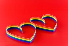 2 сердца, краска флага цвета голубого в красном цвете. стоковые фотографии rf