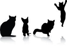 2 силуэта установленных котами Стоковые Изображения