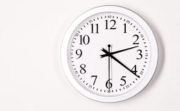 Plain White Wall Clock Shows Time 2:21 Stock Image