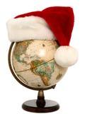 2 3个地球帽子圣诞老人 免版税库存照片
