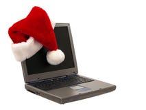 2 3个帽子膝上型计算机圣诞老人开会 库存照片
