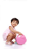 2-3 years old baby girl. 2-3 old year baby girl holding plastic box Royalty Free Stock Photo
