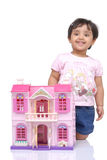 2-3 years old baby girl. With doll house over white background Royalty Free Stock Photography
