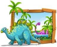 2 динозавра в деревянной рамке Стоковые Фотографии RF