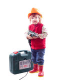 2 años de bebé en el casco de protección con el taladro y la caja de herramientas Imágenes de archivo libres de regalías