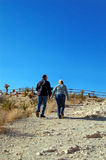 2 adults walking up a path. A Royalty Free Stock Image