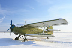 An-2 airplane. And the winter airdrome Royalty Free Stock Photography