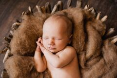 Free 2. An Infant Sleeping With Her Hands Under Her Cheeks At A Newborn Photoshoot Stock Image - 210468091