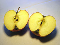 2 apple halfs. Two apple slices on canvas stock photography