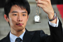 2 asian man pocket watch Royaltyfri Fotografi