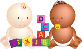 2 babies play with building blocks. With letters on Stock Photo
