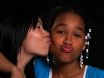 2 beautiful girls. With different ethnic backgrounds Stock Images