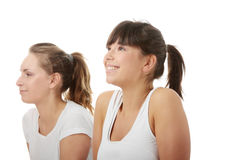 2 Beautiful young womans doing yoga exercise Stock Photography