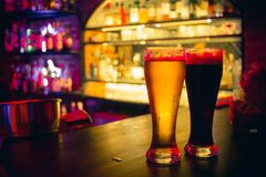 Free 2 Beer Glasses At The Bar Counter Stock Photo - 103985010