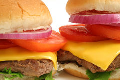 2 Big Cheeseburgers w/the works upclose. Shot of 2 Big Cheeseburgers w/the works upclose Stock Images
