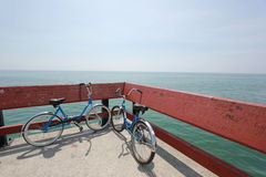 2 Blue Beach Cruiser Bike Near Green Ocean during Daytime Stock Photography