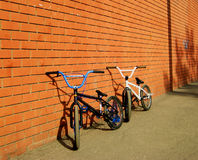 2 BMX Bicycles. Near the brick wall Stock Images