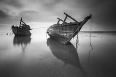 2 Boats on the Body of Water Under Cloudy Sky during Daytime in Greyscale Photo Stock Photography
