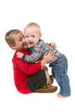 2 Brothers Hugging Eachother on White Background Stock Image