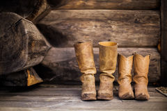 2 Brown Leather Boots on Wooden Staircase Royalty Free Stock Image