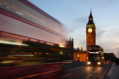 2 Buses Passing by Near Big Ben Stock Images