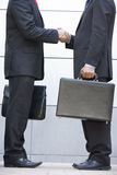 2 businessmen meeting outside office. Detail of 2 businessmen meeting outside office Stock Photos