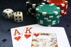 2 cards with chips and dice on a table Stock Photos
