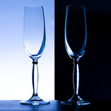 2 champagne glasses. On a black and light blue background royalty free stock photography
