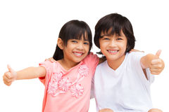 2 Child Making thumbs up with a Smiling Stock Image