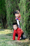2 children playing outdoors Stock Photos