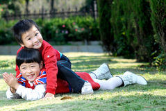 2 children playing outdoors Royalty Free Stock Photography