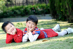 2 children playing outdoors Stock Photo