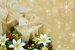 2 Christmas Presents with ribbon and bows . Beautifully wrapped presents with gold sparkle background Royalty Free Stock Photos