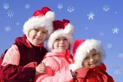 2 claus ungar som leker santa Arkivfoto
