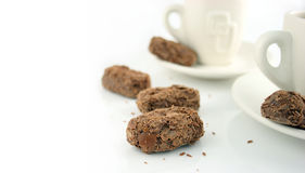 2 Coffee cups and chocolates. Time for a break - 2 Coffee cups on a white background with chocolates Stock Photos