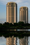 2 condo towers. Reflected on the water stock images