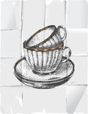 2 cups with saucers. 2 hand drawn cups with saucers over paper background Stock Images
