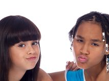 2 cute girls. With different ethnic backgrounds and expressions Stock Photos