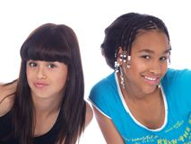 2 cute girls posing. 2 cute girls with different ethnic backgrounds Stock Image