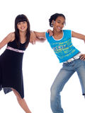 2 cute girls posing. 2 cute girls with different ethnic backgrounds Stock Photography