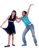 2 cute girls posing. 2 cute girls with different ethnic backgrounds Royalty Free Stock Photo
