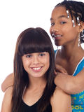 2 cute girls posing. 2 cute girls with different ethnic backgrounds Royalty Free Stock Image