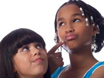 2 cute girls posing. 2 cute girls with different ethnic backgrounds Royalty Free Stock Photos