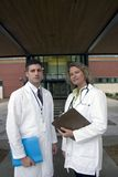 2 doctors outside of hospital. Team of 2 doctors outside of hospital royalty free stock photography