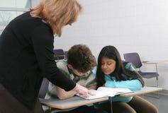 2 estudiantes y profesores Imagenes de archivo