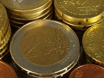 2 Euro and Cent. 2 Euro coins surrounded by Cents Royalty Free Stock Images