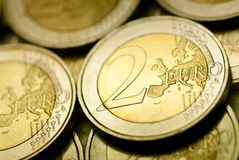 2 euro currency - close up. Two euro currency close up with details and lot of other coins Royalty Free Stock Image