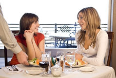 2 friends having lunch at a cafe Stock Images